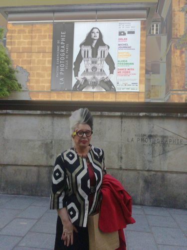 ORLAN in front of poster