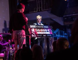 Eric Daman holds Grand Prize check